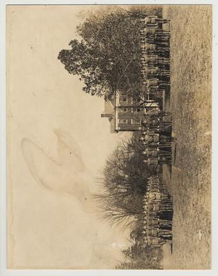 Company in formation, possibly training troops for World War I.  Frazee Hall in the background