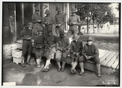 University of Kentucky military technical training during World War I.  Cadets on a walk ramp counting their money