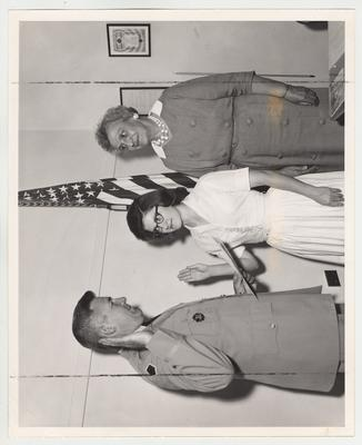 Miss Martin being commissioned for the Army Reserve Officers Training Corps