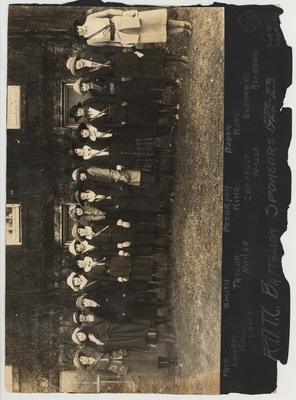 On this side is the 1922-23 Reserve Officers Training Corps Battalion Sponsors.  From left to right: Pate, Conroy, Rash, Lavin, Smith, Taylor, Baker, Peterson, King, Chenault, Wells, Boden, Ruby, Shropshire, Ashbrook.  On the second side of the photo is the 1922-23 Military Band posing on the steps of Barker Hall