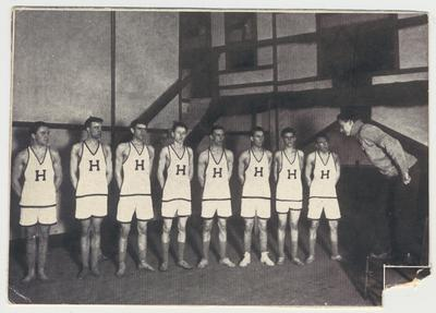 The Strollers theater group portraying a basketball team in an unidentified play.  This image is in the 1912 Kentuckian on page 311