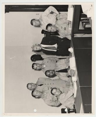 Kentucky State Police.  Standing from left to right: Major Dameron, Major Braden, Captain Loob, Doctor Vandenbosch, Major Lindquist.  Sitting from left to right:  Captain Joseph, Lieutenant Crowder, Major Smith