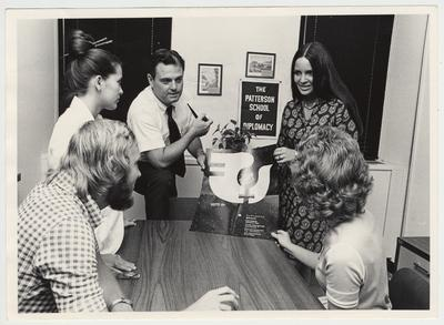 In 1971 Vince Davis became the director of the Patterson School of Diplomacy and International Commerce.  Vince Davis is discussing the World conference on Women with four unidentified individuals