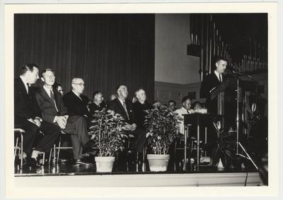 Former President Herman Donovan (fifth from left), Governor A. B. Chandler (fourth from left) and unidentified men are listening to President Frank Dickey (at podium)