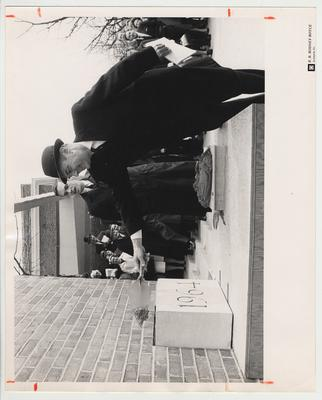 President Frank Dickey putting mortar on the cornerstone of Dickey Hall