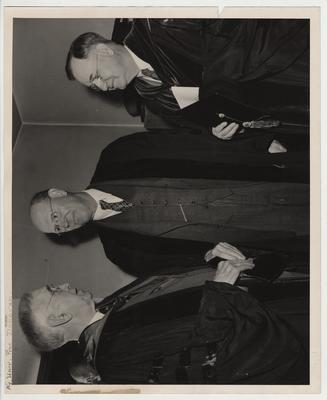 From the left: Frank L. McVey, Professor Tigget, and Herman Lee Donovan in graduation robes