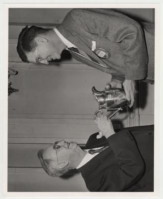 Albert Kirwan presenting the Optimist Cup to former president Donovan