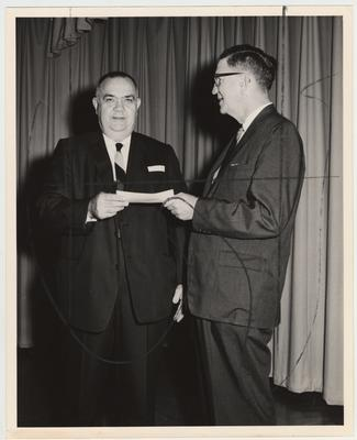 Dean Albert Kirwan on the right with Stanley Wall, Vice President of the Community College System, on the left