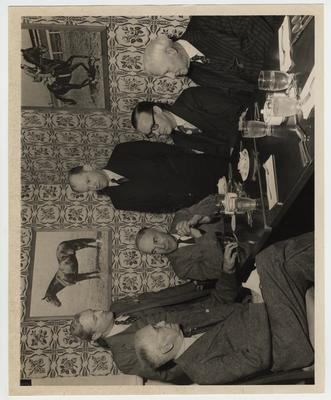 A luncheon for Archibald MacLeish.  From left to right: Frank L. McVey; Professor Grant C. Knight; Archibald MacLeish; Doctor Herman Spivey; A. B. Guthrie, Junior; Doctor L. L. Dantzler