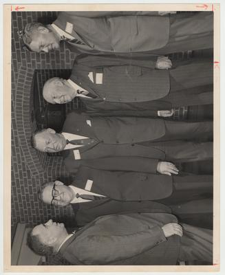 President John Oswald (far left) is talking with a group of unidentified men