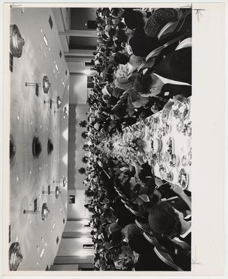 Unidentified people eating at President Oswald's inaugural luncheon in the ballroom of the Student Center