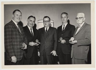 President John Oswald (second from left) and three other men are recipients of an award from the Land Bank