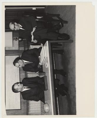 Seated from left to right: Mr. Foley, Assistant Secretary of Commerce; president John Oswald; Arnold DeWalt Albright, University of Kentucky Vice President of Administration