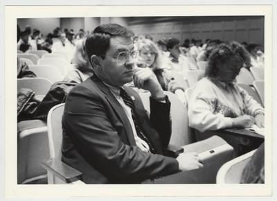 President Roselle (left) seated among students during a lecture in an unidentified lecture hall