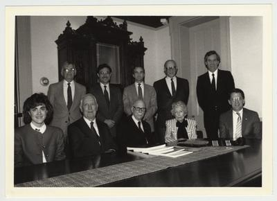 Several people seated at a conference meeting.  On the first row, second from the left is historian Dr. Thomas Clark.  The man on the far right of the back row is doctor Raymond Betts, a history professor and the head of the Gaines Center.  President Roselle is on the far left of the front row
