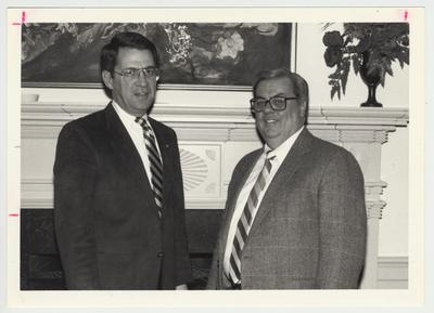President Roselle (left) is standing with Mr. Guthrie in the front hall of Spindletop Hall