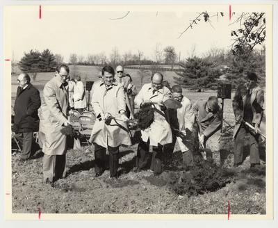 President Roselle (second from left), Scotty Baesler, Mayor of Lexington  (far left) and four unidentified men are shoveling dirt at a groundbreaking ceremony for an unknown technological building