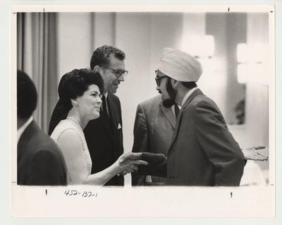 A reception for the introduction of Doctor Singletary (third from right, standing next to his wife Gloria) to the University Community as the new University President in 1969.  This photo is in the 1969 Kentuckian on page 137