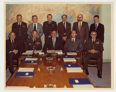 A meeting of the Department of the Army, Historical Advisory Committee in Washington.  Standing, from the left:  Colonel Roger H. Nye, US Military Academy; Professor Harry L. Coles, Command and General Staff College; Brigadier General Robert G. Yerks, US Army War College; Professor Peter Paret, Stanford University; Professor Edward M. Coffman, University of Wisconsin; and Professor Frank Freidel, Jr., Harvard University.  Seated, from the left:  Dr. Marice Matloff, Chief Historian, Center of Military History; Brigadier General James L. Collins, Jr., Chief of Military History; Dr. Otis A. Singletary, University of Kentucky and Chairman of the Department of the Army Historical Advisory Committee; Professor Russell F. Weigley, Temple University; and major General Burnside E. Huffman, Jr., US Army Training and Doctrine Command