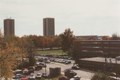 A color photo of the Blanding and Kirwan Towers (in the background towards the left), Commonwealth Stadium C. M. Newton Field (in the background to the right), Haggin Dormitory (towards the front on the right), and K-Lair Grill (on the right, in front of Haggin Dorm). This photo was taken in the fall of 1996 by Terry Warth