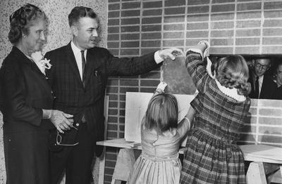 The dedication of Blazer Hall was on October 14, 1962. This photograph is of President Dickey and Mrs. Paul Blazer with her grandchildren, Barrie and Martha. Photo received from the Lexington Herald-Leader