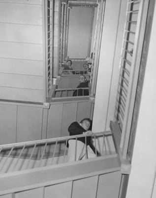 Five unidentified men in the stairway of a dorm