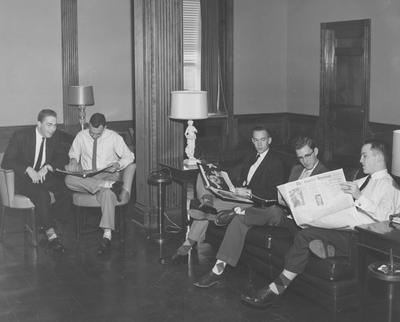 Five unidentified men sitting and socializing inside Bowman Hall
