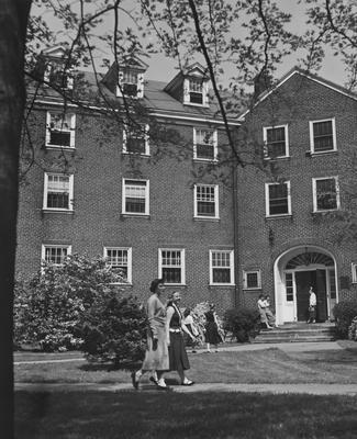 Seven unidentified women in front of Boyd Hall, a woman's dormitory. Boyd Hall was built in 1925 and was named after Cleona Boyd