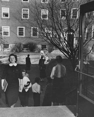 Unidentified women are to and from Boyd Hall, a woman's dormitory. Boyd Hall was built in 1925 and was named after Cleona Boyd