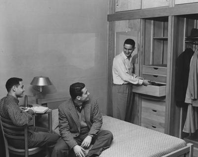 Three unidentified men are talking in a bedroom of Donovan Hall