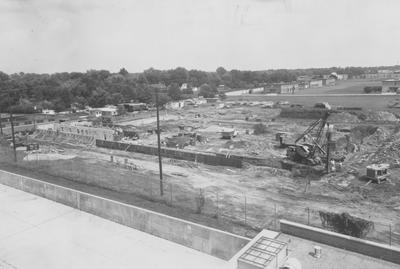 Construction of Haggin Hall, seen from Donovan Hall. Fraternity Row in the background. Haggin Hall was named after James B. Haggin and dedicated on September 16, 1960. Received July 31, 1959 from Public Relations