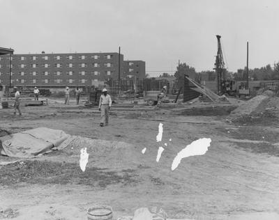 Unidentified men are working on the construction of Haggin Hall. Haggin Hall was named after James B. Haggin and dedicated on September 16, 1960. Received July 31, 1959 from Public Relations