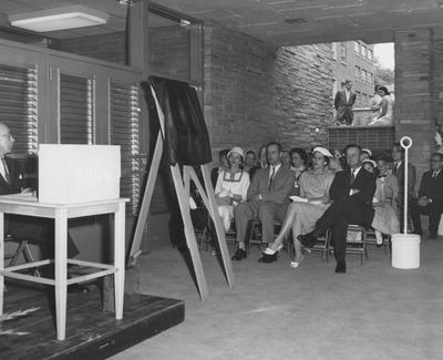 The Sarah Holmes family, listening to the dedication of Holmes Hall on May 25, 1958. Received May 25, 1958 from Public Relations