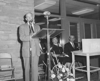 Dean Sarah Bennett Holmes (second from right), Dr. William V. Gardner of First Presbyterian Church (far right) and President Frank Dickey (third from right) are listening to Frank Peterson speaking at the dedication of Holmes Hall on May 25, 1958. Received May 25, 1958 from Public Relations
