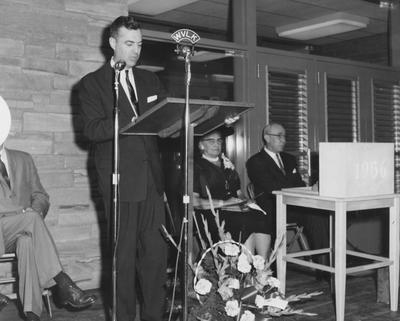 Dean Sarah Bennett Holmes (second from right) and Dr. William V. Gardner of First Presbyterian Church (far right), are listening to President Frank Dickey speaking at the dedication of Holmes Hall on May 25, 1958. Received May 25, 1958 from Public Relations