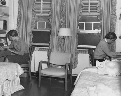 Two unidentified women are in their dorm room in Holmes Hall. Photographer: University of Kentucky