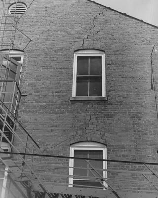 A side of Patterson Hall showing cracks in the bricks. Patterson Hall was completed in 1904 and was named after James K. Patterson. Received June 1, 1959 from Public Relations