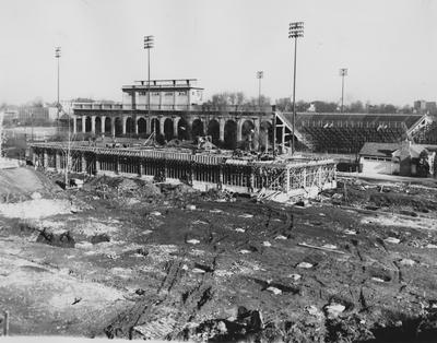 Construction of the Fine Arts Buildingand a view of the McLean Stadium and Stoll football field. Photographer: W. E. Sutherland