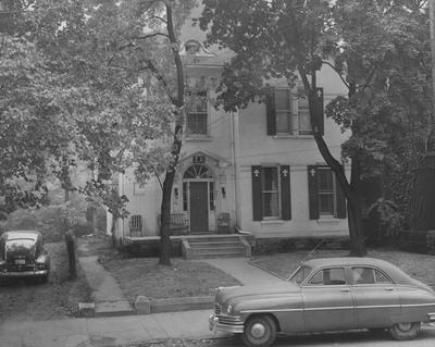 The front of the Sigma Chi house on South Limestone. This building was destroyed in the summer of 1959. Photographer: Mack Hughes
