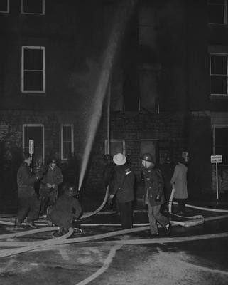 Firefighters battling 1956 blaze at Frazee Hall. Frazee Hall was built in 1907 and named after David Frances Frazee on June 3, 1931. Photographer: University of Kentucky