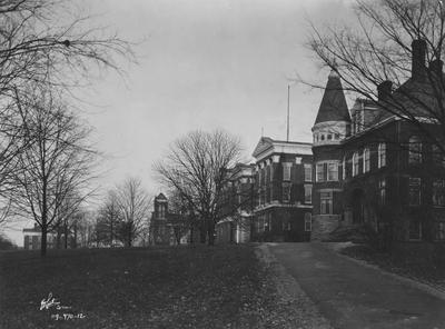 Photograph taken from Administration Drive (looking north). From left to right: Education Building, now Frazee Hall, Alumni Hall (Gymnasium), Administration Building-Old Science and Late Law Building, and Gillis Building, shown in the 1920