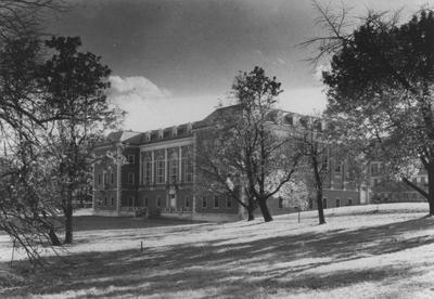 Margaret I. King South Library with porch. Porch was destroyed and front lawn filled in when the north wing was built in 1974. Development (central) used this print for a publication