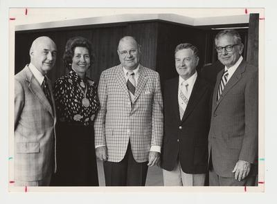 President Singletary is standing with members of the 1975 Board of Trustees.  From the left:  Albert Clay; unidentified woman, winner of medallion; William Sturgill, coal operator and contributor to the University of Kentucky (Sturgill Development Center at Rose Lane and Rose Street is named for him); unidentified man; President Singletary