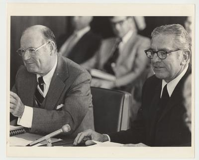President Singletary (right) is seated next to William Sturgill (left) and is seated among others at an unidentified meeting