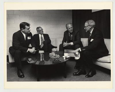 From the left:  Vince Davis; President Singletary; Gerald Ford, former President of the United States; and John Sherman Cooper, United States Senator.  The men are sitting in conversation before a seminar sponsored by the Patterson School of Diplomacy which was held in Memorial Coliseum