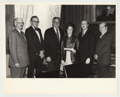 President Singletary (third from the left) is standing with five unidentified people