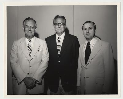 President Singletary (center) is standing with two unidentified men at a Georgia Alumni Function (?)