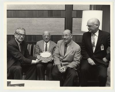 From the left:  President Singletary; Floyd Wright; William Sturgill;  and Peter Bosomworth; Chancellor of the Medical Center.  Floyd Wright is being presented with a birthday cake