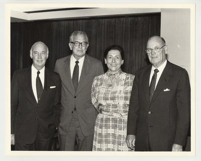 From the left:  Albert Clay, President Singletary, Sally Hermansdofer, and William Sturgill.  They are standing and posing for a picture at a meeting of the Board of Trustees