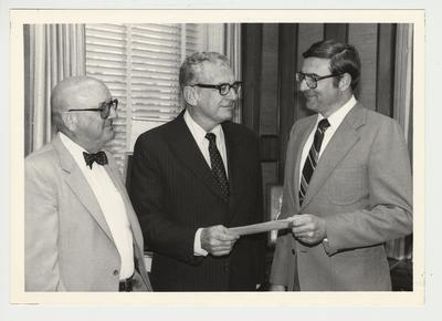 Harned L. Day Jr. gives a check from the Dupont Company to the University of Kentucky.  From the left:  W. R. Coner, sales Dupont; President Singletary; Harned L. Day, Jr. of Dupont